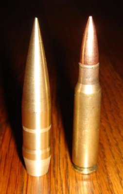 .50 bullet standing with a.308 Winchester cartridge